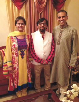 IHA- Houston chapter president Swapan Dhairyawan (right) and his wife Pallavi with Sarvesh Asthana.