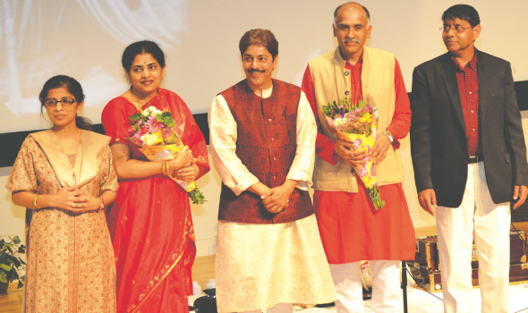 Indian Consul General P. Harish (center right) lauded the guru-shishya parampara (student-teacher tradition) fostered by Pandit Shantilal Shah. Joining them on stage were Hema and Ravi Iyer, founders of the Swaralayam Arts Forum (far left and far right) and Mrs. Nandita Harish.