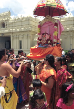 Devotees in procession at Sri Meenakshi temple carrying Utsava Vigraha of Sri Vasavi