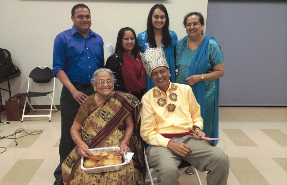 The Golikeri family enjoys a light hearted moment at the 90th birthday celebration of their matriarch, Radha, who was feted at a large gathering of friends and family last Saturday, April 26. Grandchildren (left to right) Rohit, Reema and Rita and daughter-in-law Ranjana and son Sudhir enjoyed the moment. They also celebrated Sudhir's upcoming birthday (the next day) with a crown and impromptu flute in the traditional Marathi style.