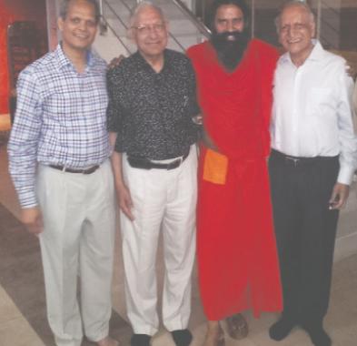 From left: Shekhar Aggarwal, Durga Aggarwal, Swami Ramdev, and Braham Aggarwal.