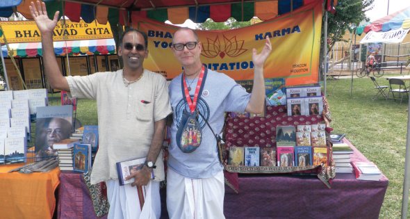 Dayal Nitai Das (David Garvin) an ISKCON devotee for 5 years and husband of Voice of Asia Editor Shobana Muratee, worked the book stall with Radha Vinod Das (Ravi). Garvin and Ravi received their initiation rites from their Guru Giriraj Maharaj on Monday, May 19 at the temple, and took their new names.