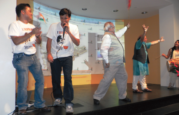 Modi's victory in India was celebrated with a program that had patriotic songs and an impromptu dance by Masterji Trivedi