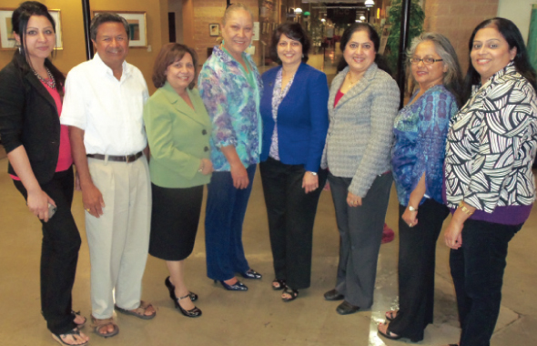 Faculty and staff with Houston Community College Board of Trustees Chair Neeta Sane (fourth from right) and Dr. Sena Gomez, President, HCC Southwest College (fourth from left). From left, Rima Adil, Bharat Sutaria, Ajanta Barua, Dr. Anna Koshy, Reni Abraham and Dr. Ritu Raju.
