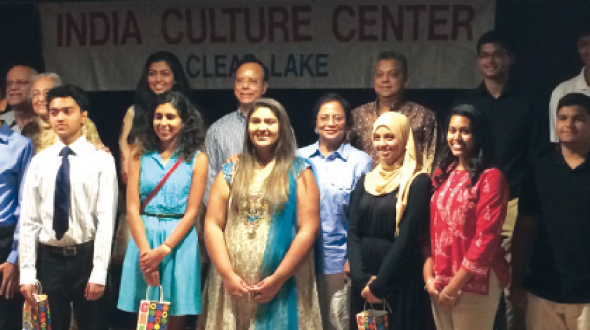 Graduating high school students of Indian origin (front row) stand with ICC Clear Lake senior citizesn, including Dr. Syamal Poddar (center, rear), who gave the keynote address.