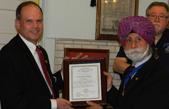 Right Worshipful Charles Cupples, District Deputy Grand Master for Masonic District 108 (left) presents the award to Raj Bhalla while Secretary Jim Starks looks on.