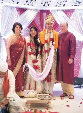 The bride Priya Thakker and the groom Gautam Sane with the groom's parents Neeta and Deepak Sane.      Photo: Jason Henry