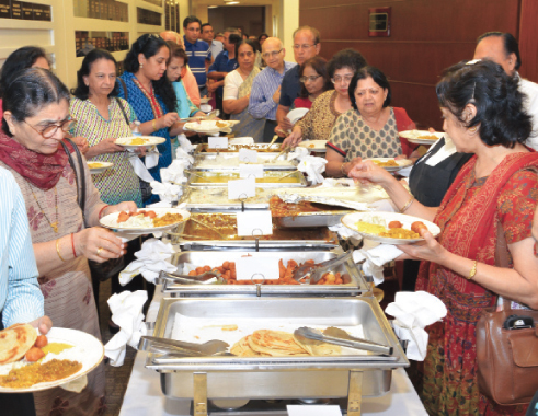 Attendees enjoying the authentic Bangalorian food catered by Udipi restaurant.
