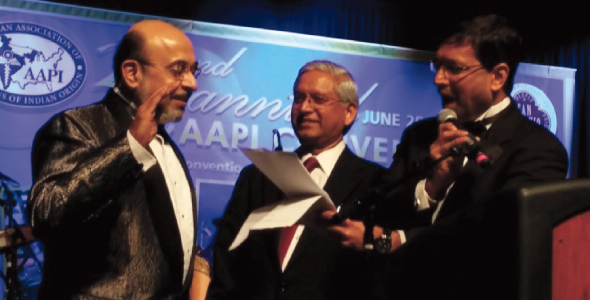 Dr. Jayesh Shah administering the oath of office to Dr. Ravi Jahagirdar. Also in the picture is Dr. Shashi Shah, Chairman, Board of Trustees, AAPI.