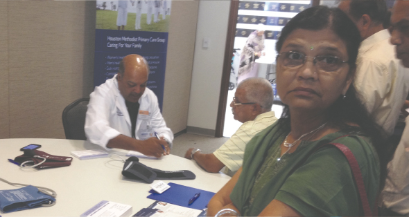 Dr. Mahendra Jain(left) organized a health fair and diagnostic counselling with representatives from Houston Methodist Sugar Land Hospital, Randall's and his own practice.
