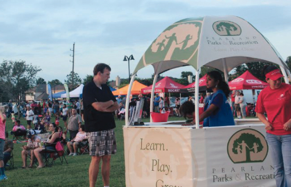 Pearland city Parkas and recreation booth was frequented by attendees here showing MTS volunteer Mythri Ravoori at the desk