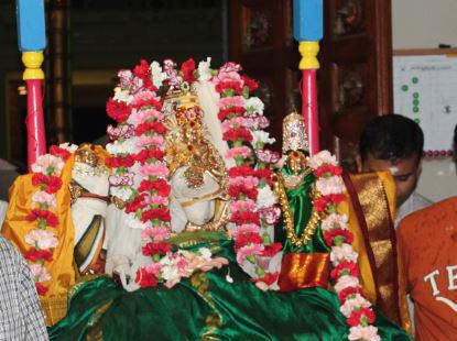 Devotees carrying Lord Nataraja Utsava Murthy in a procession at Sri Meenakshi temple during Aani Thirumanjanam.