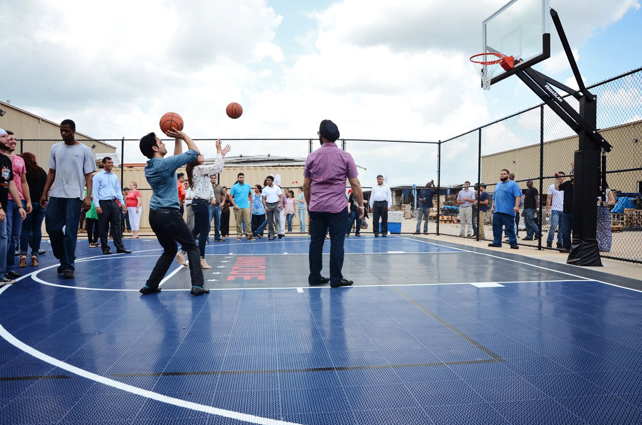 Pankaj Malani (with ball) joined employees in a quick game of basketball.