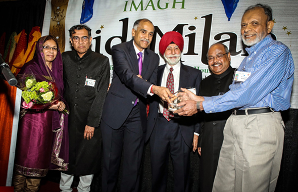 Indian Consul  General Parvathaneni Harish handing out the Community Award to Basheer Mohammed as, from left, Mrs. Mohammed, presenter Maqbool Haq, Col. Raj Bhalla (in red turban) and IMAGH Presidient Latafath Hussain enjoy the moment.
