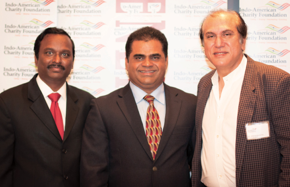 IACF President Ramesh Cherivirala (left) and Board Director Jawahar Malhotra flank FBISD Trustee K. P. George