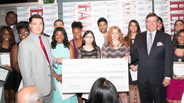 Ft Bend District Attorney John Healy (left) and FBISD Trustee Jim Rice (right) with some of the students who received part of the $25,000 scholarship fund that the IACF distributed.