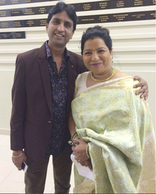 Dr. Kumar with Abha Dwivedi, who was not only the master of ceremonies for the evening but also one of the organizers of the Houston show.