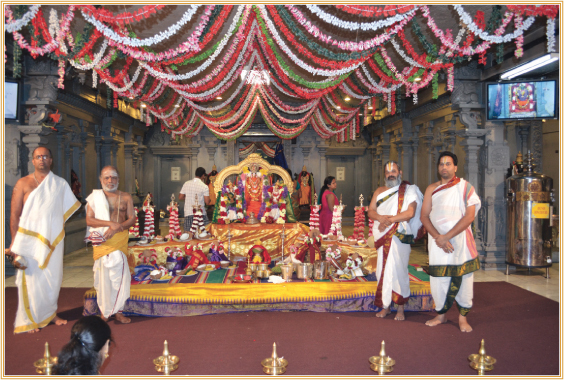 MTS Priests, Sri Parameswaran, Sri Mannickasundaram Bhattar, Sri Sridharan Raghavan, Sri Pavan Kumar in front of the divine beauty of Perumal with Sri devi and Bhoodevi, with eight lamps