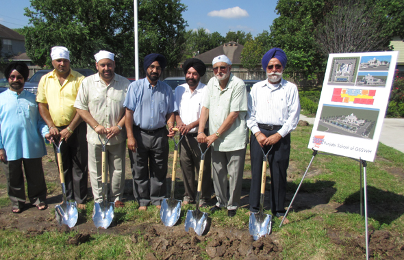 The Building Committee members and major donors pose with the ceremonial shovels at the groundbreaking ceremony.