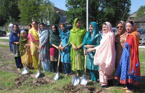 The volunteer teachers of the Punjabi School with the ceremonial shovels.