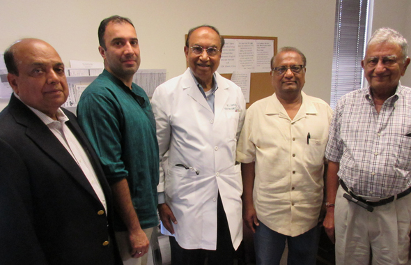 At the IDC, from left Club 24 and Spring Branch Rotary's Ashok Garg; Dr. Raghu Athre, the Indian Doctors Association Presidnet; Dr. K. T. Shah, the Clinic Director; K.C. Mehta, the IDC Secretary and Treasurer and Dr. Satish Jhingran, a Director of the clinic.