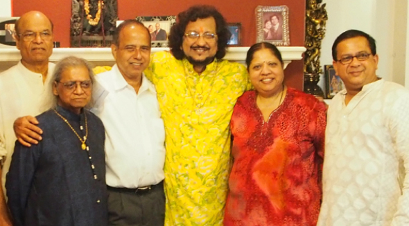 Govinda Shetty, Suresh and Usha Shenoy and Sanjay Rao with the artistes post-concert.