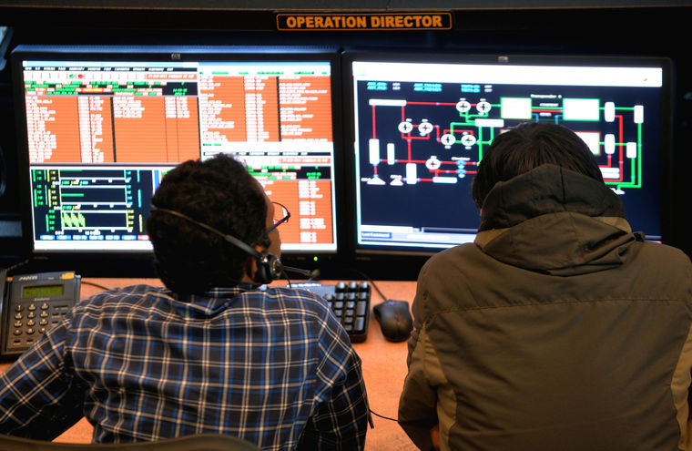 Indian scientists and engineers at the Indian Space Research Organization monitor the Mars Orbiter Mission at the tracking center, ISRO Telemetry, Tracking and Command Network in Bangalore Nov. 27, 2013 (Getty Images)