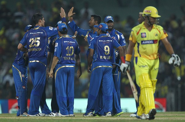 Mumbai Indians players celebrating fall of Suresh Raina`s wicket during the match between Chennai Super Kings and Mumbai Indians at MA Chidambaram stadium in Chennai on April 6, 2013. (Photo: IANS)