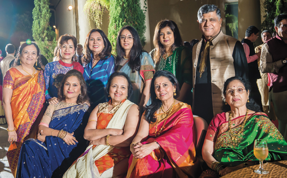 Pradeep Gupta with ladies representing Club 24 members and guests.
