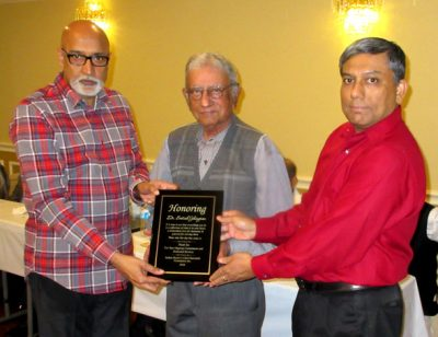 Dr. Satish Jhingran receives an award from Indo American Charity Foundation President Nanda Vura (left) and Sushvon Guha, IACF Board Director