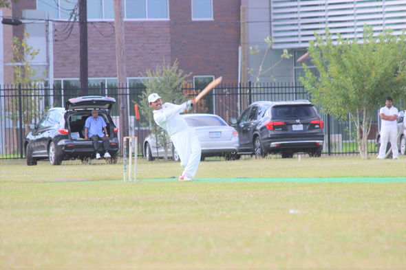 Man of the Match Kishore from Houston Oilers Cricket Club (HOCC) hitting a boundary in the 18th over against CJCC.