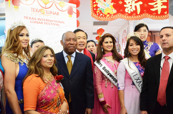 Houston Mayor Sylvester Turner with Texas International Lunar Festival Chairman Wea Lee behind him, TV Houston founder Sangeeta Dua and several local area beauty queens.