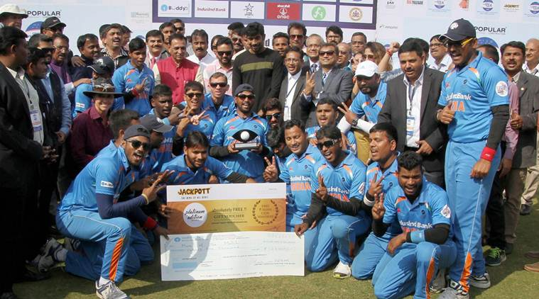Ahmedabad: Gujarat Chief Minister Vijay Rupani with blind Indian cricket team players at Blind Cricket Tournament 2nd T20 World Cup 2017, at Sardar Patel Stadium Navarangpura in Ahmedabad on Saturday. PTI Photo(PTI2_4_2017_000121B)