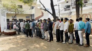 Lucknow: Voters queue up to cast their votes during the third phase of the UP assembly elections in Lucknow on Sunday. (PTI Photo)