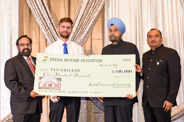 Ian Grillot (second from left) receives a check for $100,000 from India House Houston trustee Charlie Yalamanchili (left) and India House Gala Chair Jiten Agarwal (far right) with Indian Ambassador to U.S. Navtej Sarna. Photo: Bijay Dixit