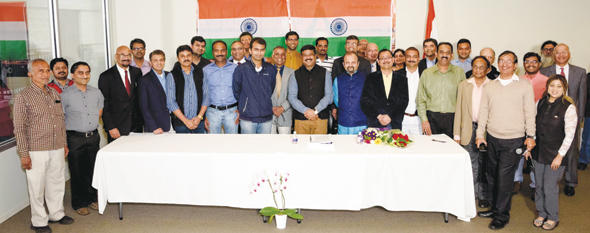 After the meeting, the gathering of community wellwishers came together tp pose with the Minister Pradhan (center) for a group photo.