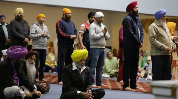 "Men and women attend Sunday services at the Gurudwara Singh Sabha of Washington, a Sikh temple in Renton, Wash., Sunday, March 5, 2017, south of Seattle. Authorities said a Sikh man said a gunman shot him in his arm Friday, March 3, 2017, as he worked on his car in his driveway and told him ""go back to your own country."" (AP Photo)"