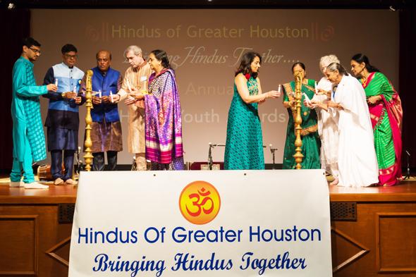 Diya lighting ceremony was performed by Rishi Bhutada (left), Jugal Malani, Vishnu Ramnarine, Gurinder Luthra, Ranjana Narasiman, Suhag Shukla, Manjulaben Patel, Beth Kulkarni, Dr. Hansa Raval and Thara Narasimhan.