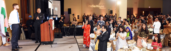 Ian Grillot (left) receives applause and cheers from India House Gala Chair Jiten Agarwal (center) and the audience at the India House Gala on March 25 in Houston. Photo: Bijay Dixit