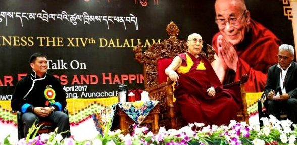Tibetan spiritual leader the Dalai Lama with Arunachal Pradesh Chief Minister Pema Khandu during a religious talk at Kalawangpo Hall at Tawang in Arunachal Pradesh on Monday.(PTI Photo)