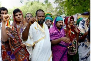 Protesting Tamil Nadu farmers dress as women as they continue with their demand seeking compensation for drought in the state on Saturday in New Delhi. Photo: PTI