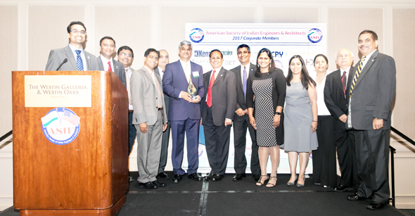 Dr. Karun Sreerama, Keynote Speaker; received a memento from ASIE Board of Directors and Advisory Council. From left: Raj Basavaraju, Sirish Madichetti, Ashish Bagga, Naresh Kolli, Chetan Vyas, Dr. Karun Sreerama, ASIE President Dinesh D. Shah, Madhu Kilambi, Chaitanya Gampa, Archana Sharma, Tej Kour, Ravi Arora, Gaju Patel.