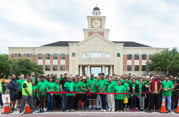 Walk Ribbon cut by Rep Ron Reynolds, TX District 27 with sponsors of the BAPS Charities walkathon.
