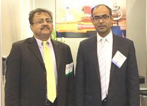 Picture on Right: T J Sinha (left), President of Dartex Industries Inc, Texas at his booth with Deputy Indian Consul General Surendra Adhana at the OTC.