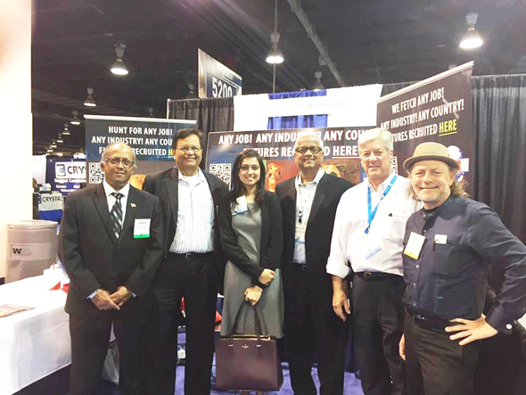 Ramesh Anand (left), President of American Personnel Services with visitors to his booth: Gitesh Desai (second from left) and his brotherPradeep Anand (third from right)and their friends and colleagues.