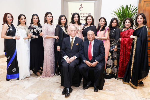 The Board of the Save A Mother Houston Chapter, with the founder Dr. Shiban Ganju, seated at left with Nat Krishnamurthy, the Treasurer.