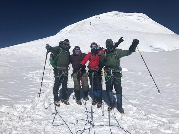 From left: Rick Pal, Dawa Sherpa, Navraj Pradhan, Mike Hobson. Post summit with Mere Peak behind us.