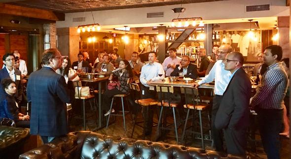 Dr. Arun Pasrija addressing TiE Houston Members.