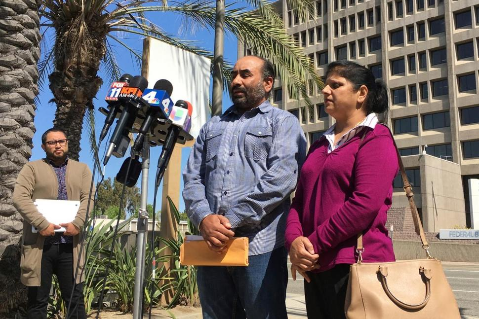 Gurmukh Singh, accompanied by his wife, talks during a news conference prior to his immigration check-in outside the Immigration and Customs Enforcement's offices in Santa Ana, Calif. on Monday, May 8, 2017. Singh a taxi driver originally from India has been detained by U.S. immigration authorities during a check-in for an 18-year-old deportation order. (AP Photo/Amy Taxin) THE ASSOCIATED PRESS
