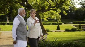 German Chancellor Angela Merkel, centre and Indian Prime Minister Narendra Modi, walk through the garden of the government guest house Meseberg Palace, during a meeting in Meseberg, about 70 kilometers (43 miles) north on Berlin, Monday, May 29, 2017. AP/PTI